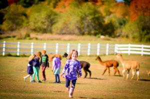 Student running at farm