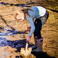 student-shoveling-mud-scaled-circle